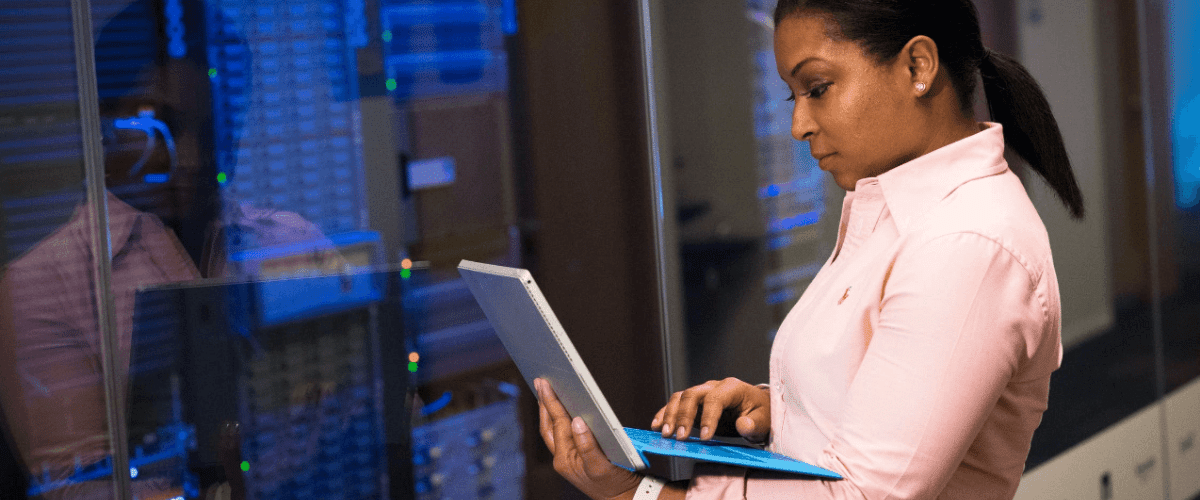 Woman working on server